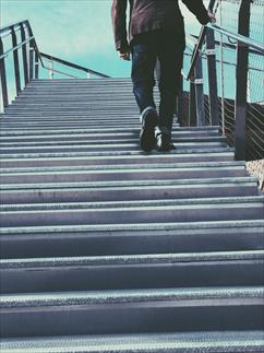 Image of a person walking up steps