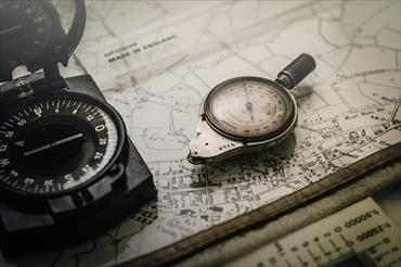 Image of compasses on a map